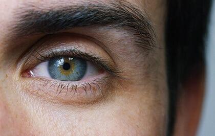 Close up men's blue eye