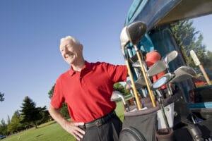 older man playing golf