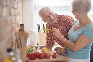 older couple sharing food
