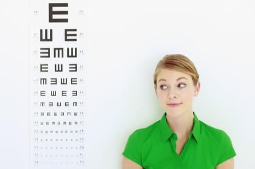 woman standing next to eye chart